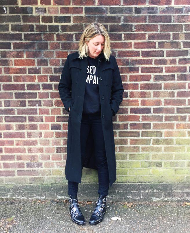 black coat black jeans black jumper givenchy boots
